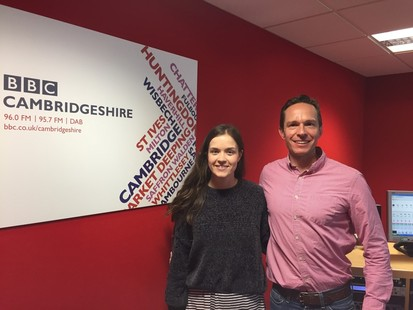 Lucy And Jeremy Posing For A Picture By The BBC Radio Cambridgeshire Sign After Their Live Radio Segment